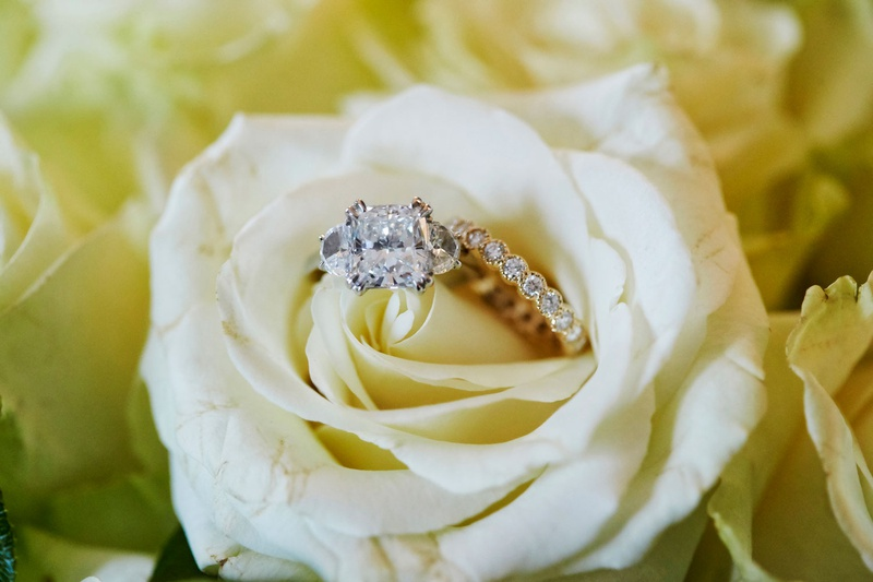 wedding jewelry engagement ring and wedding band diamond in white rose flower