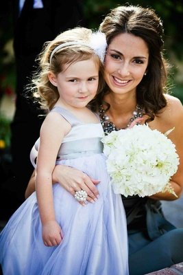 Purple flower girl dress and white hydrangea bouquet