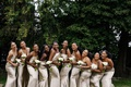 wedding party bridesmaids in champagne gold silk dresses with white calla lily bouquets