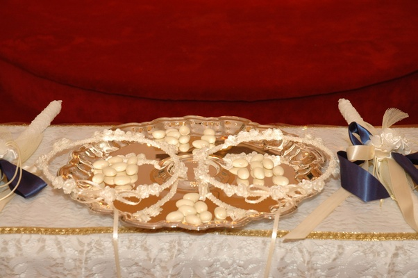 Greek Orthodox wedding crowns and candles on altar