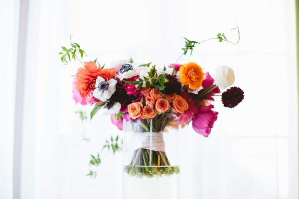 coral, fuchsia, and white bouquet, ranunculus blossoms, dahlias, garden roses, anemones