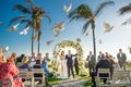 doves being released ceremony outside animals hotel del coronado california wedding bride groom bird