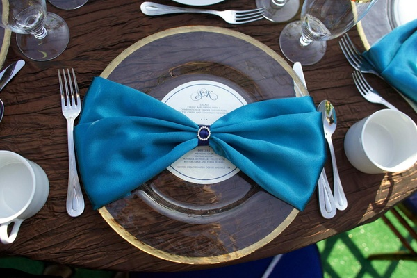 Blue linen napkin and gold-rimmed charger plate