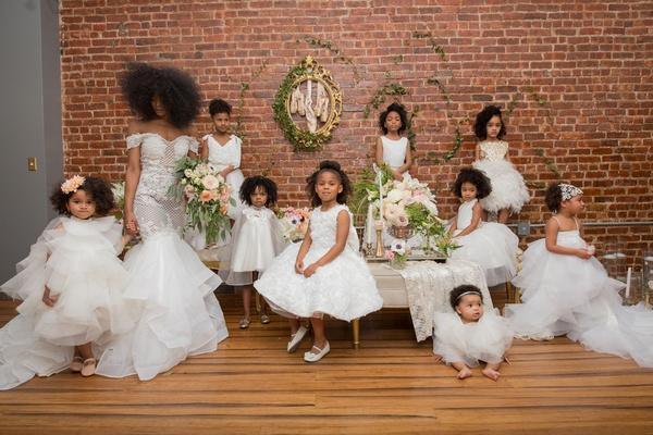 bride with natural hair in pantora bridal dress off-the-shoulder, pantora mini flower girl dresses