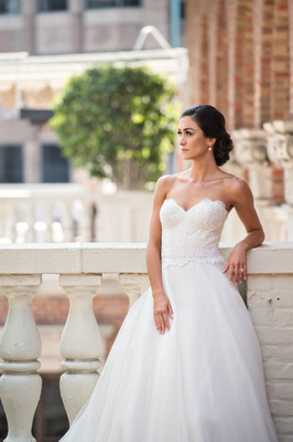bride in reem acra ball gown wedding dress with lace bodice and sweetheart neckline, tulle skirt