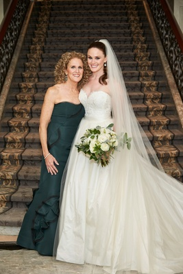 Mother of bride in deep forest green gown strapless with bride in sweetheart neckline a line dress