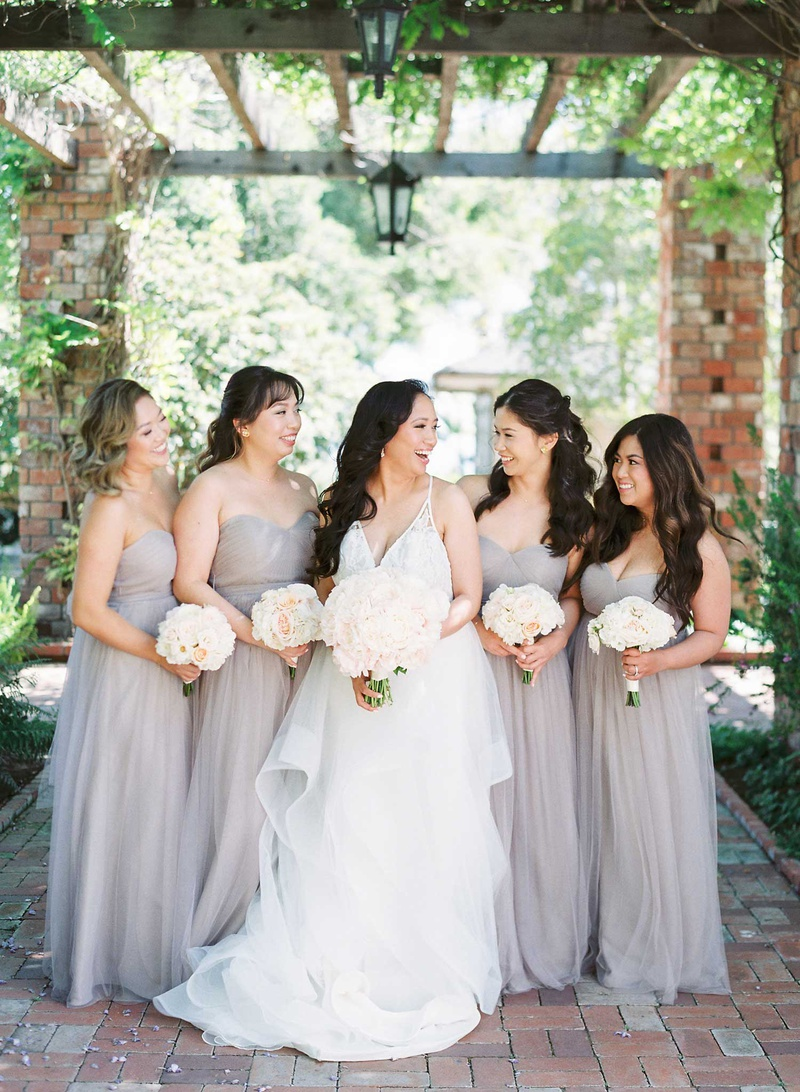65b4c714ce bride in v neck hayley paige wedding dress with bridesmaids in strapless  light grey taupe gowns