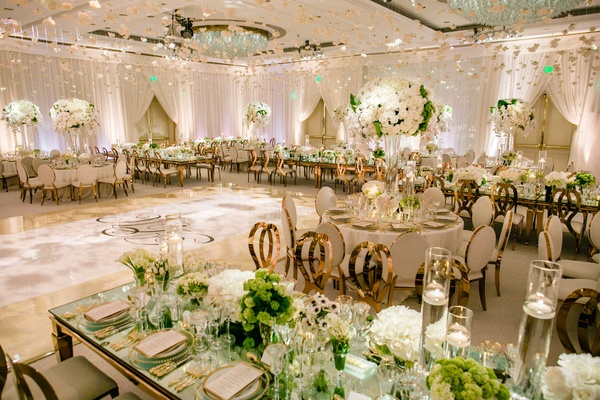 Romantic jewish wedding with lush ivory flowers amp rose gold ballroom wedding reception ivory cream mirror table rose gold chairs green centerpieces junglespirit Gallery
