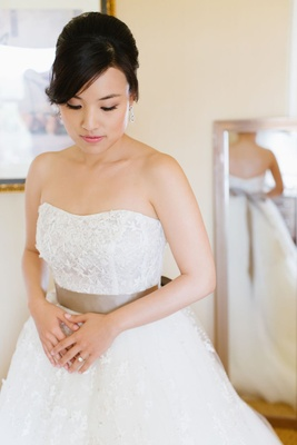 strapless ball gown with taupe ribbon belt