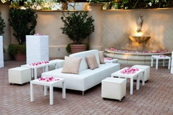 White furniture with pink rose petal decorations