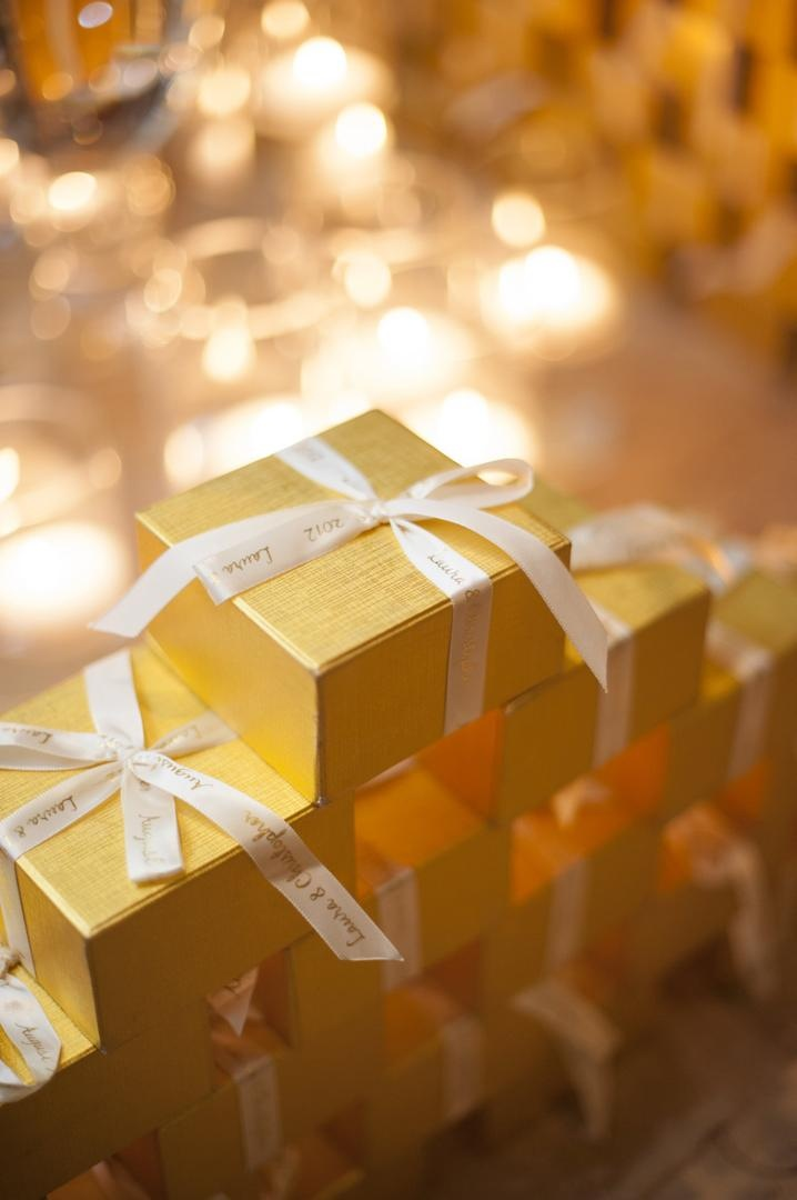 Personalized ribbon on gold wedding favor boxes