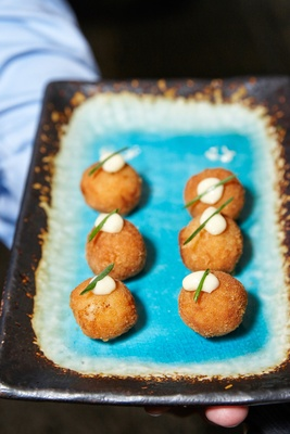 croquette appetizer served at the cocktail hour of the waldorf astoria chicago wedding
