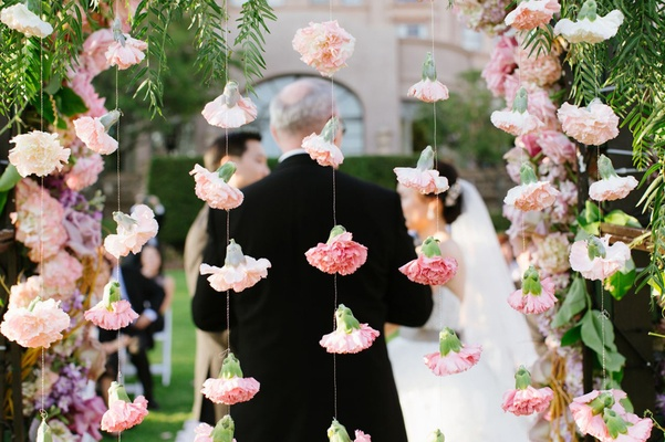 rosebuds attached to string hang as garlands