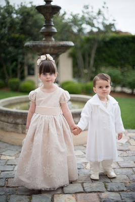 Flower girl in short sleeve ball gown bangs updo flowers ring bearer in boots and white jacket