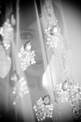 Black and white photo of Indian bride and beaded veil