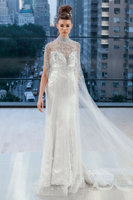 """Amsterdam"" Ines Di Santo fall 2018 wedding dress long cape with silver embellishments high neck"