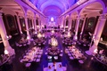 Aerial view of Vibiana wedding reception with purple lighting and chandeliers over mirror tables