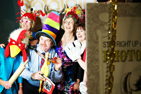 Wedding guests take photos with funny props