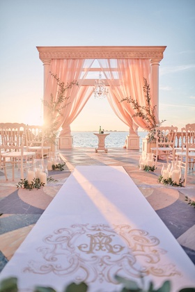 ornate monogram on aisle runner for wedding ceremony overlooking sarasota bay