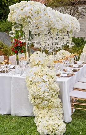 towering centerpieces with orchids and glass orbs, floral table runner