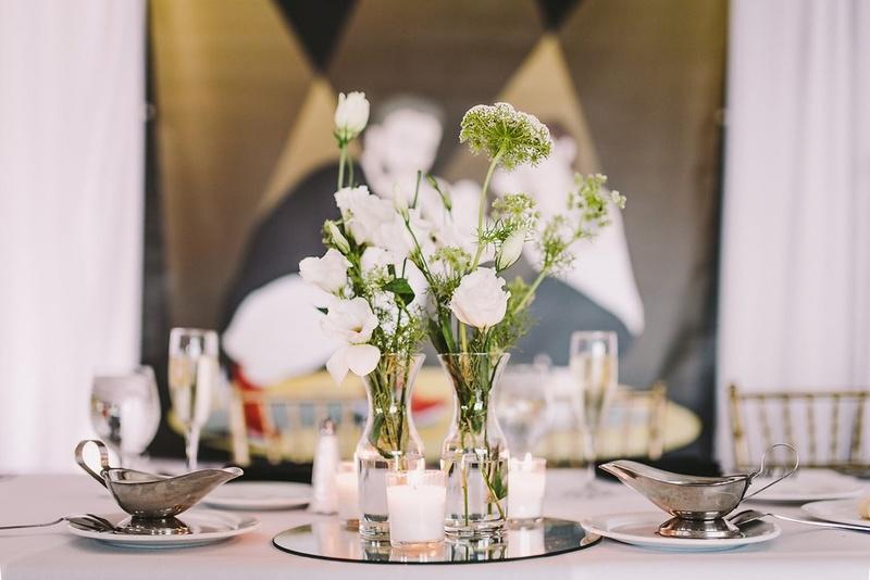 Reception Décor Photos - Bud Vases on Mirror - Inside Weddings