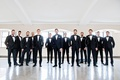 groom with groomsmen in matching tuxedos bow ties and white pocket squares chicago wedding