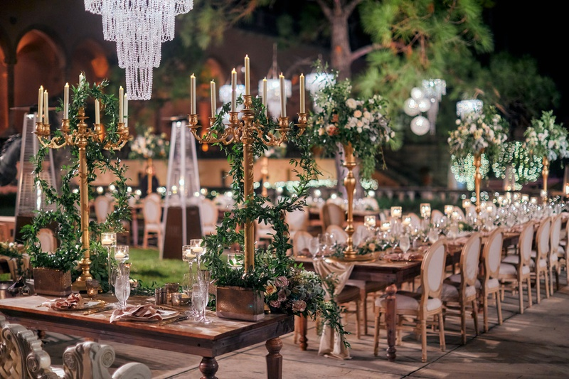 ringling museum wedding reception with gold candelabra and lots of greenery