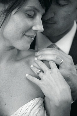 Black and white photo of couple's rings