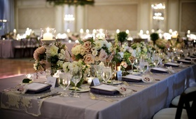 Silver linens topped with blush and ivory flowers