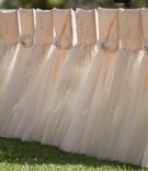Pink wedding ceremony chair covers with tulle skirts