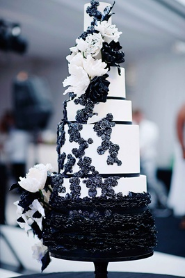 Black and white modern wedding with unique details in cincinnati black and white cake with ruffles sugar flowers and ribbons mightylinksfo