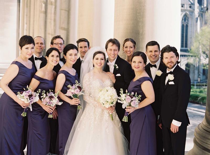 bridal party purple black outside roman catholic church bridesmaids groomsmen dresses suits classic