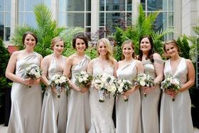 bride with bridesmaids in silver mismatched bridesmaid dresses necklines halter v neck one shoulder