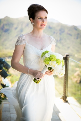 reem acra wedding dress with beaded cap sleeves and twisted bodice