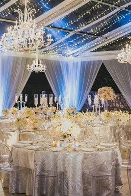 clear top reception tent with drapery, twinkle lights and chandliers