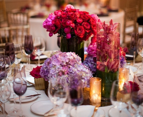 Purple hydrangeas and hot pink roses in vases
