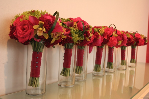 vases in a line filled with bridesmaids bouquet