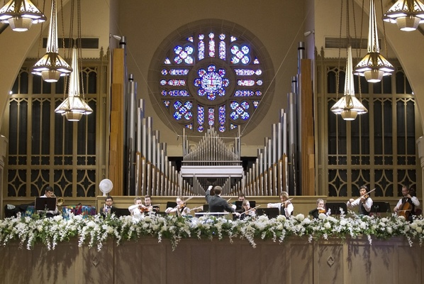 Church wedding with stained glass window and orchestra pit