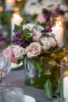 small wedding reception centerpiece pink rose anemone buds and purple flowers