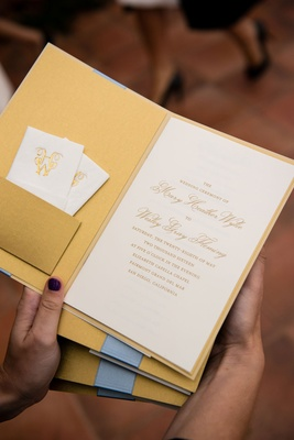 Gold ceremony program with pocket and white kleenex tissue monogram with gold foil