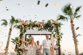 bride and groom excited after wedding ceremony and confetti cannon
