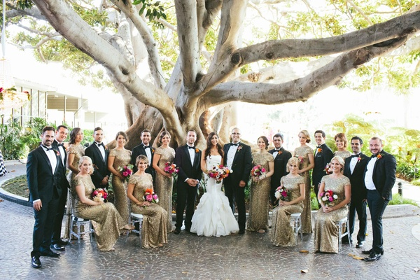 white, gold, and black attire, colorful bouquets and boutonnieres, bridal party