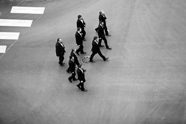 Black and white photo of groomsmen on street bird's eye view