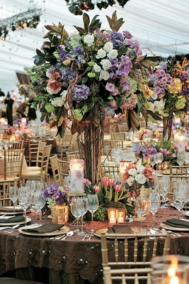 Floral centerpieces with branches and candles