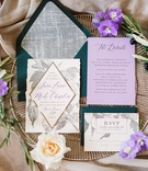 wedding invitation suite, forest green envelopes, lavender insert, silver flowers