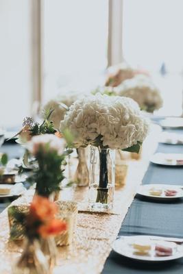 white hydrangea bridesmaids bouquet, black linens, gold runner, head table