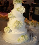 White classic wedding cake with fresh roses