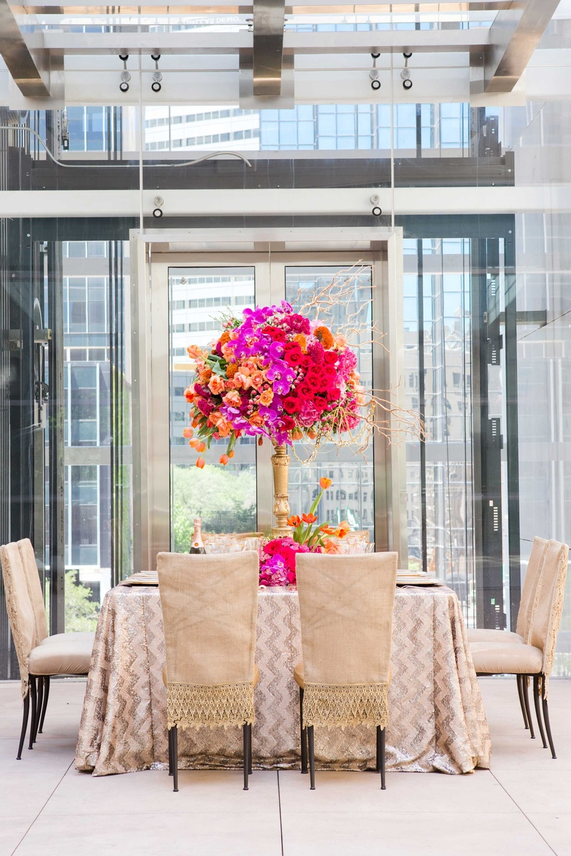 bold table champagne colored chair covers vibrant flowers chevron print table linen wedding