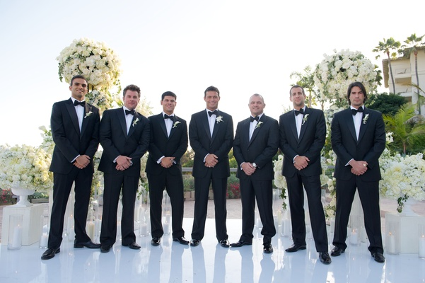 Romain Zago with six groomsmen in tuxes and bow ties