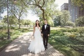 bride in hayley paige a-line gown with sequin details, groom in tuxedo, chicago park wedding picture